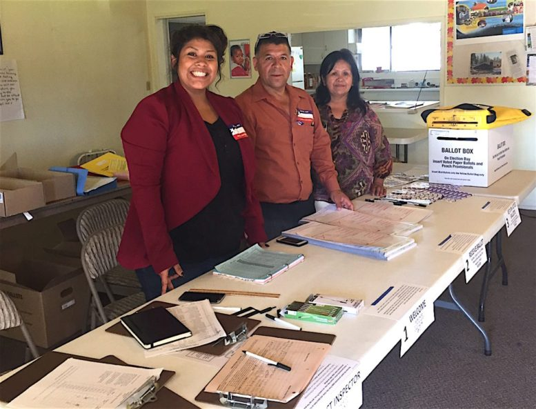 The crew at Precinct 457-800, Escondido Community of Christ Church, 1140 Maple St., led by poll worker Cindy Resending, left.