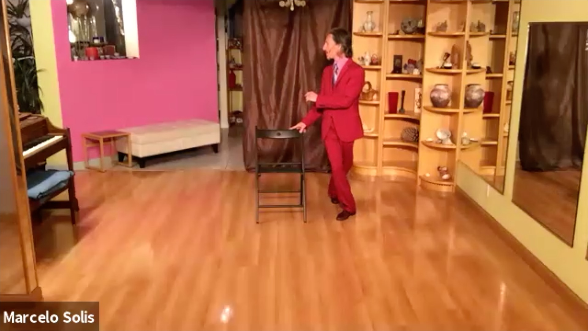 Argentine Tango class: chair exercise with backward ochos