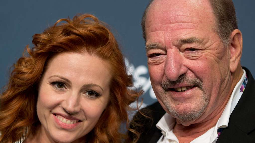 Valentina Monetta on the left and Ralph Siegel on the right pose for a photograph.