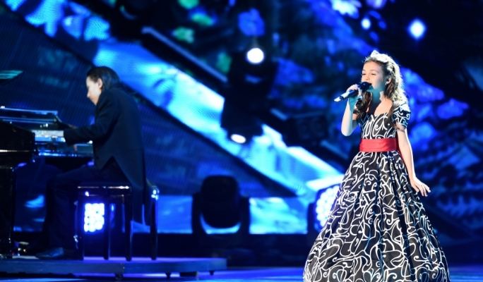 Krisia Todorova and Hasan & Ibrahim Ignatov perform on stage for Bulgaria in Malta at the Junior Eurovision Song Contest 2014.