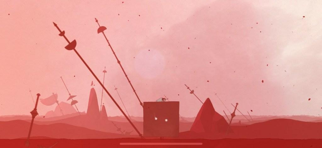 Captura de pantalla de GRIS. Se muestra a la protagonista convertida en cubo. Escenario con tonos rojizos.
