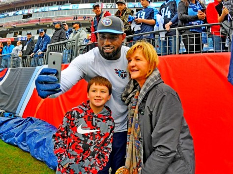 Nov 29, 2015; Nashville, TN, USA; Tennessee Titans tight end Delanie Walker (C) poses for a photo with fans prior to the game against the Oakland Raiders at Nissan Stadium. Mandatory Credit: Christopher Hanewinckel-USA TODAY Sports
