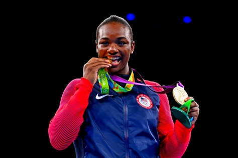 RIO DE JANEIRO, BRAZIL - AUGUST 21:  Gold medalist Claressa Maria Shields of the United States poses on the podium during the medal ceremony for the Women's Boxing Middle (69-75kg) on Day 16 of the Rio 2016 Olympic Games at Riocentro - Pavilion 6 on August 21, 2016 in Rio de Janeiro, Brazil.  (Photo by Alex Livesey/Getty Images) ORG XMIT: 631399811 ORIG FILE ID: 593233110