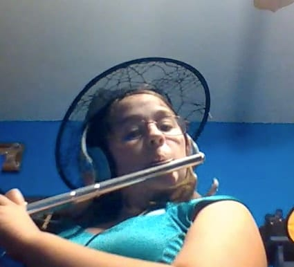 girl playing flute recording virtually
