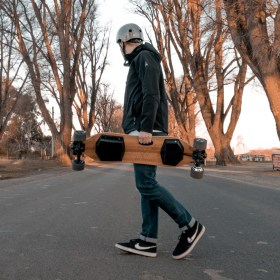 Me carrying my WowGo electric skateboard