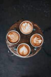 4 cups of coffee on a tray