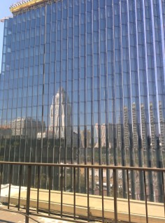 City Hall reflected from a window in the Peirera corporate HQ