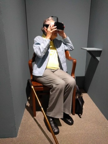 Los Angeles historian Jean Bruce Poole enjoys the virtual reality tour of Bob Winter's home