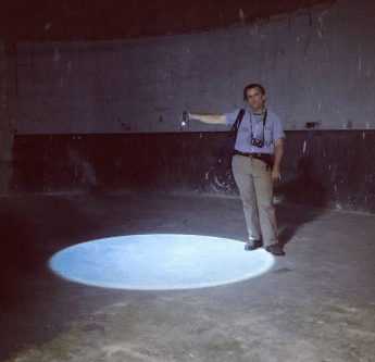 ichard Schave demonstrates appropriate use of a high powered flashlight in the sealed off pedestrian ramp at the back of the Subway Terminal Building.