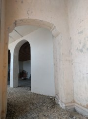 To the left of the entryway, arches march away to the north.