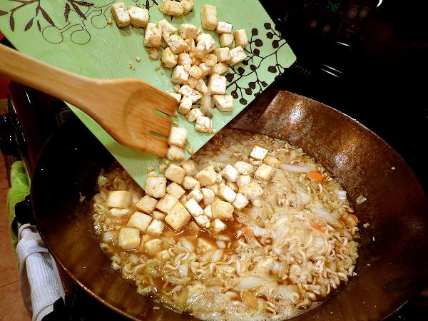 Return tofu to wok