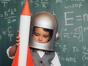 child holding a rocket