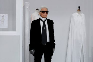 German designer Karl Lagerfeld appears at the end of his Haute Couture Fall Winter 2016/2017 fashion show for Chanel in Paris