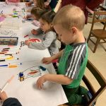 A group of children coloring.
