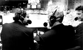 President Clinton visited with ESPN commentators Chris Berman (L) and Buck Martinez during the network's telecast of Cal Ripken's record-setting game, September 6, 1995.