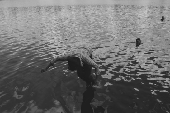 A cambodian guy dives in the waters of a volcanic lake in Ratanakiri, Northern Cambodia (2014)
