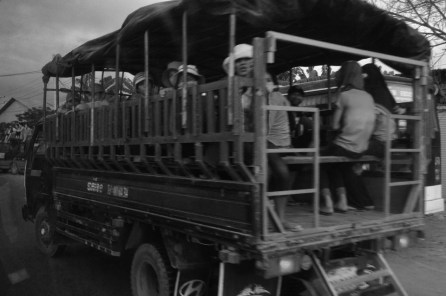 A cargo van converted as a bus leaving from Phnom Penh to Siem Reap, carries Cambodian women. Cambodia (2014)