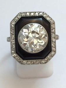 Maison Miller Bague Diamants, Onyx, Platine. Vers 1925.