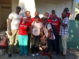 The team of providers, nurses, and translators poses at St. Anthony's