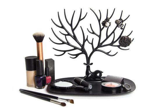 suporte para acessórios em forma de veado preto com maquilhagem e anéis