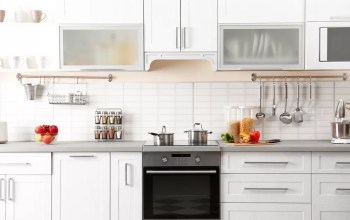 Clean white kitchen with good organization and counter storage