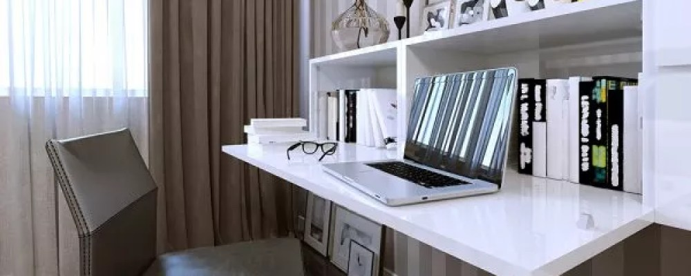 Space saving desk with a laptop on it