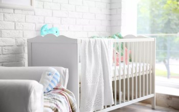 Small apartment nursery with natural lighting