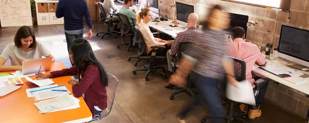 People working in a small office space
