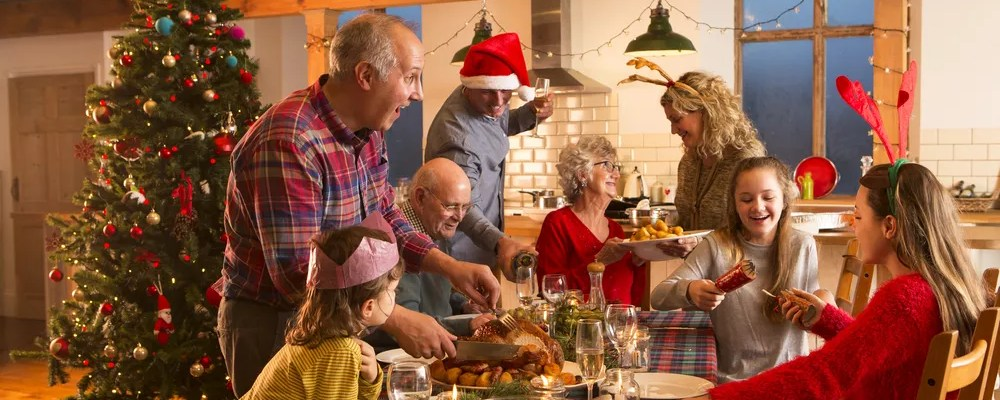 Family gathered around dining table during winter holiday celebration