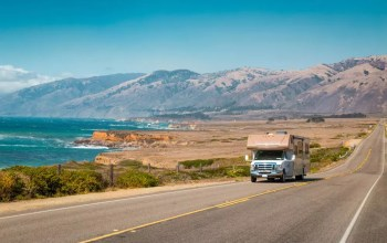 RV driving down California coast