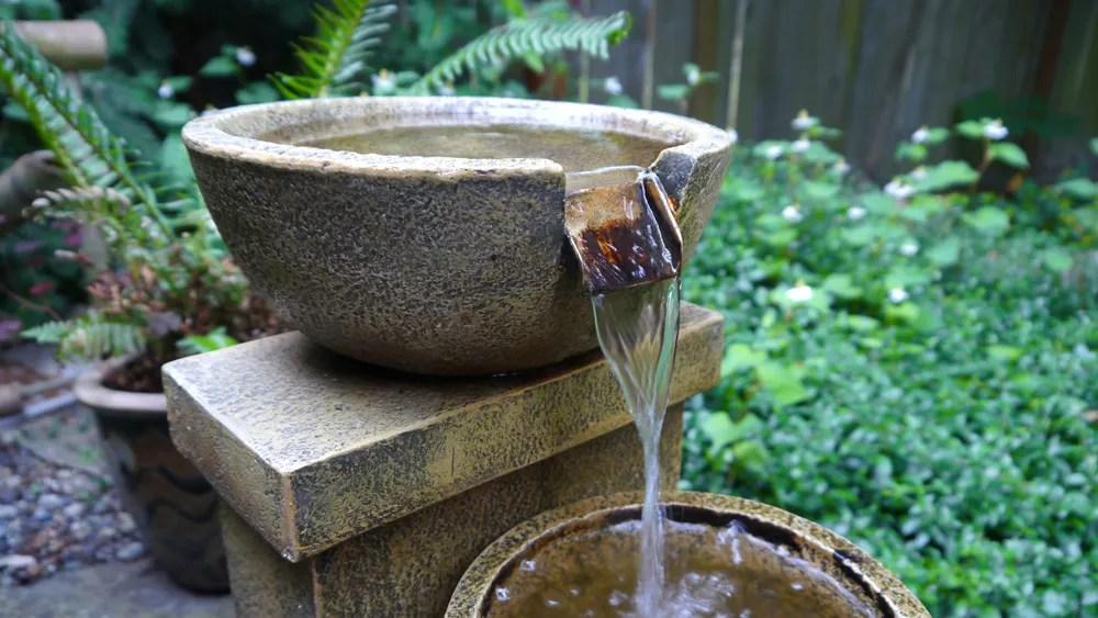 24 Outdoor Water Feature Ideas for Backyards, Gardens, & Patios via @extraspace