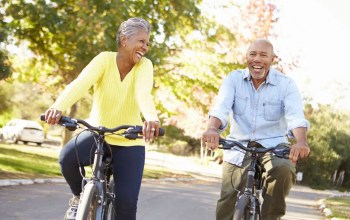 Retired couple riding bikes