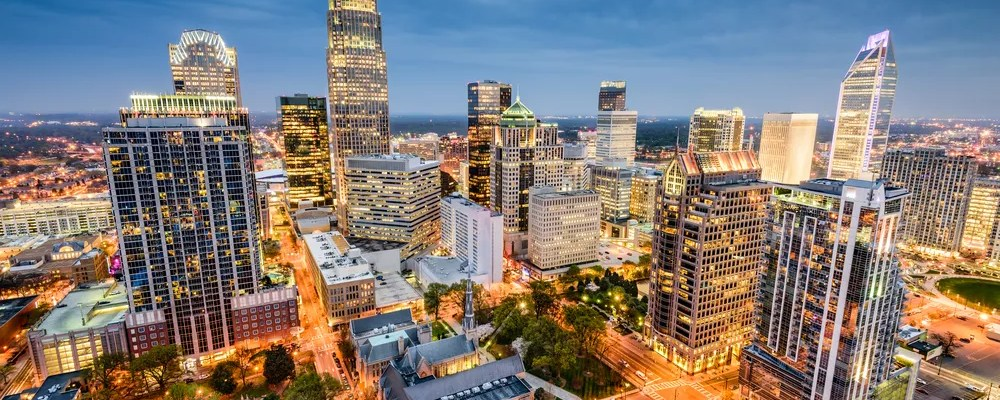 Aerial view buildings in Downtown Charlotte at night