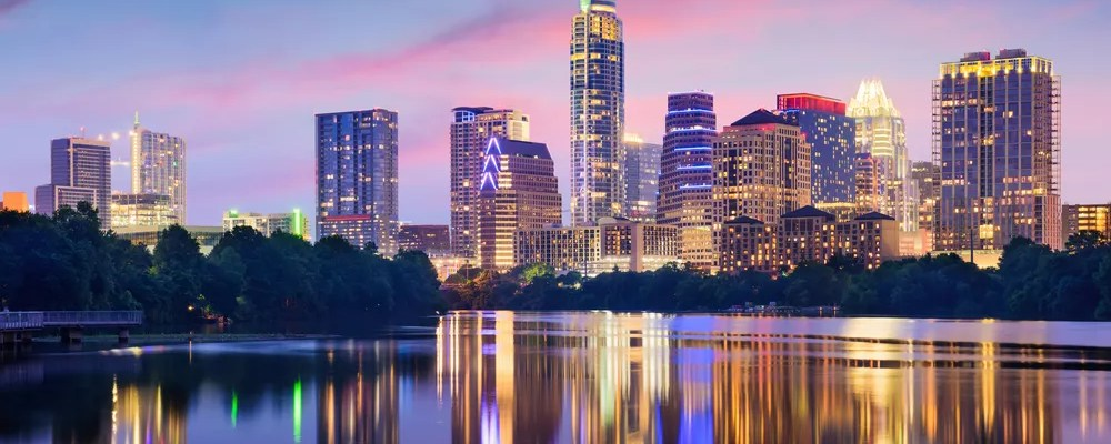 Skyline of tall buildings at night in Downtown Austin