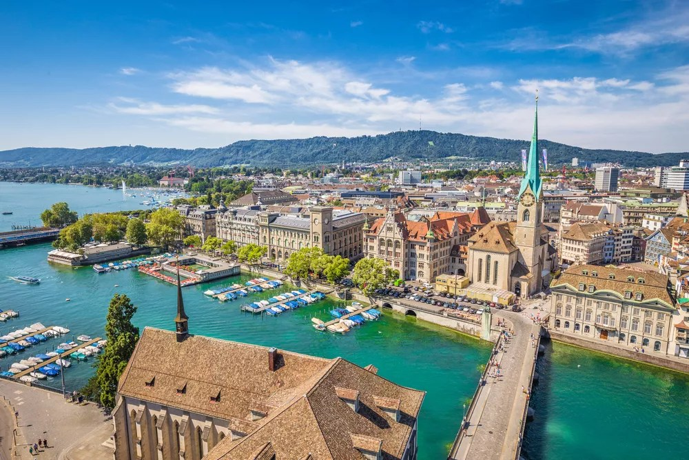 Aerial view of European town next to a harbor.