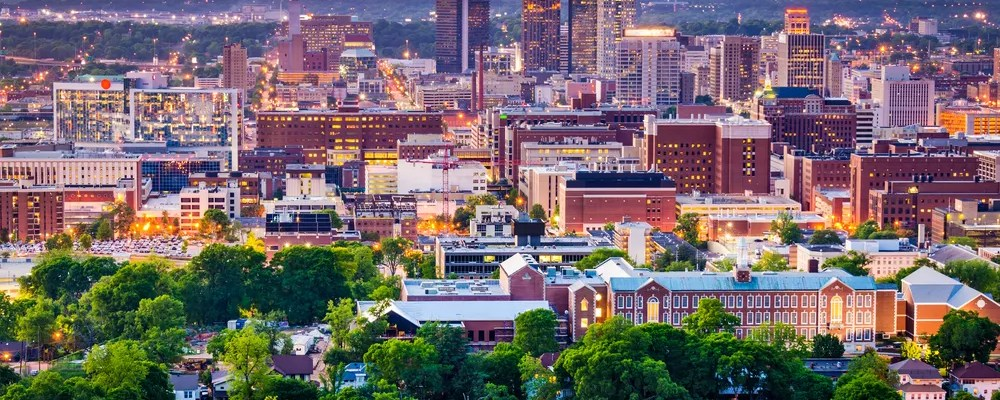Aerial view of tall buildings and trees in Downtown Birmingham