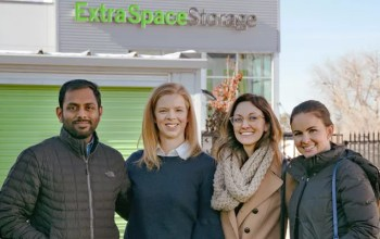 Extra Space Storage employees in front of self storage facility