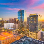 Skyline of tall buildings in Downtown Phoenix at sunset