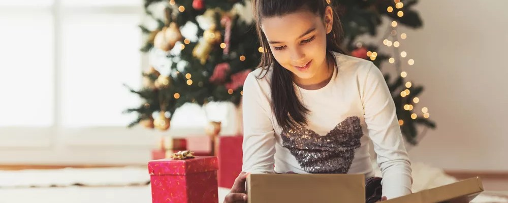 Young girl opening presents