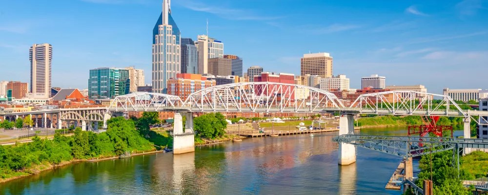 Skyline of tall buildings on sunny day in Downtown Nashville.