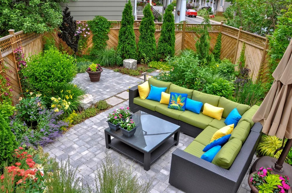 Small Backyard with Large Outdoor Seating Are and Paver Patio
