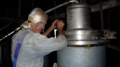 Master distiller Babis Psaroudakis locking the distillery units