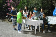 Local kids are offering drinks at the entrance