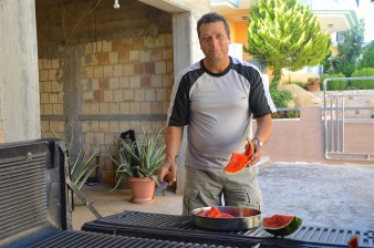 Kostis welcoming visitors with fresh melon from the field