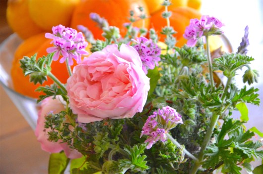 Rose with geranium in a beautiful bouquet.