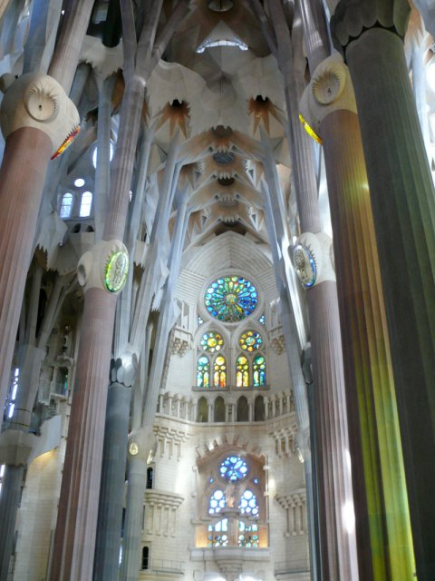 Interior of Sagrada Familia resembles a forest of huge palm trees. The effect is enhanced by a skillful lighting through the stained glass windows.