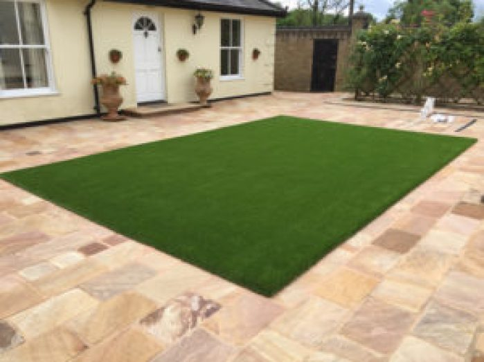 Fake grass lawn in Essex courtyard Garden
