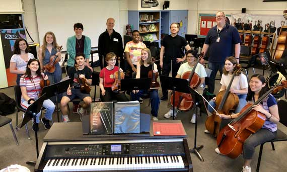 CHS string students play with the American String Quartet
