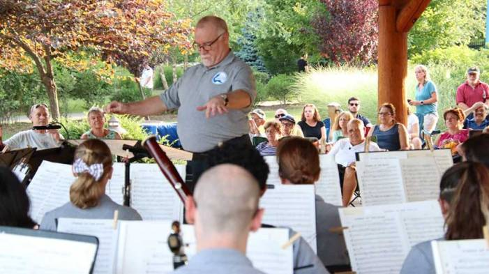 West Orange Community Band members thanks leader