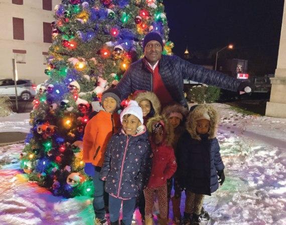 Orange lights up the city with holiday tree-lighting